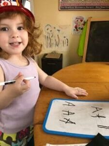 3 year old girl learning to write the abc's using The TV Teacher alphabet beats curriculum